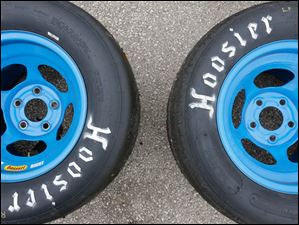 Spare wheels on pit row during the 7Up 150 at Toledo Speedway
