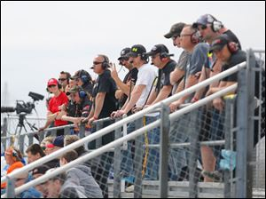 Spotters keep an eye on their drivers during the last chance qualifier for the 7Up 150.