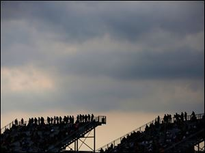 Storm clouds move over spectators during the 7Up 150 at Toledo Speedway.