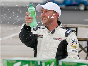 Brian Campbell celebrates after winning the 7Up 150 at Toledo Speedway.