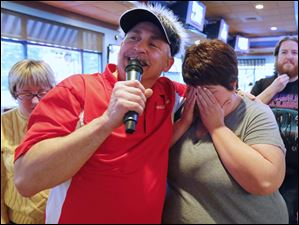 Dave Zwayer holds Randi Parton, Walbridge, as she misses an answer during trivia night at Ralphie's.