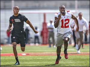 Ohio State senior Malcom Bransen competes against the Buckeyes' Doran Grant in a 40-yard dash. Grant won against the student.