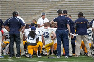 UT coach Matt Campbell speaks with the team after the spring game at the Glass Bowl. The Rockets open the 2014 season at home Aug. 30 against New Hampshire.