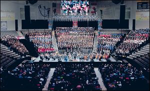 The Toledo Symphony made its Huntington Center debut with a choir of more than 1,000 voices.