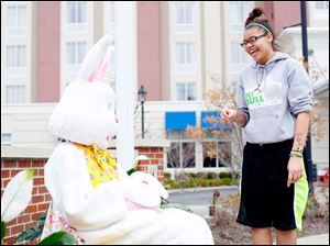 Easter Bunny, played by Jacquinno Stovall, and friend Breanna Ward laugh during an Easter egg hunt.