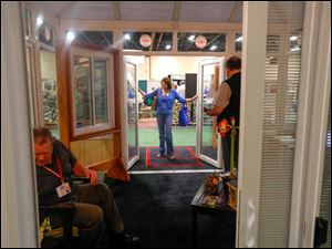 Michele Brown of Rossford checks out the doors at the Thermo-Twin Industries, Inc. booth.