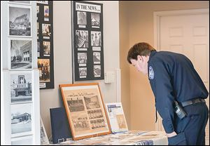 Maumee police Chief Jim MacDonald views historical memorabilia during the celebration of the 50th anniversary of Maumee Municipal Court.