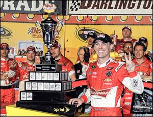Kevin Harvick celebrates in Victory Lane after winning the Sprint Cup series race at Darlington Raceway on Saturday night. It was his second victory of the season.