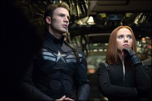 Chris Evans as Captain America, left, and Scarlett Johansson as Black Widow in a scene from