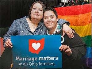 Toledoans  Kristina Quinones, left, and her wife, Jackie Quinones, celebrate Judge Timothy Black's order to recognize same-sex marriages performed in other states. A party was held at Outskirts Pub in Toledo.