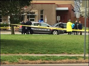 Authorities respond the Jewish community center after a shooting in Overland Park, Kan., Sunday.