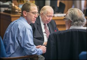 Former Foxx Liquor Store clerk Nicholas Thompson, left, speaks with attorneys Andy Douglas and Rick Kerger, right.  He is charged with selling or furnishing intoxicating liquor to a minor.