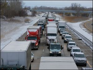Traffic is backed up on southbound I-75 near Summit Street.