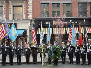 Honor Guard members line up in front of the Forum Restaurant in Copley Square, where a wreath laying ceremony was held to commemorate the one year anniversary of the bombings.