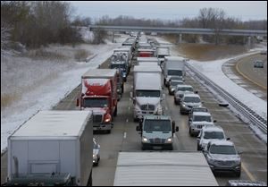 Traffic is backed up on southbound I-75 near Summit Street earlier today.