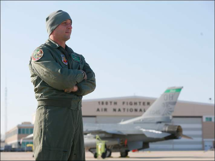 Maj. Brian Cherolis, from the 180th Fighter Wing, looks over the tarmac.