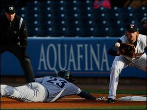 First baseman Jordan Lennerton catches the ball as Columbus Clippers CF Tim Fedroff dives safely back to first.