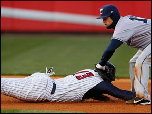 Clippers SS Justin Sellers tags out Mud Hens catcher James McCann at second base.