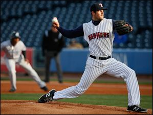 Pitcher Drew VerHagen throws against the  Columbus Clippers.