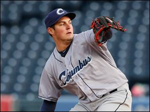 Columbus Clippers pitcher Trevor Bauer throws against the Mud Hens