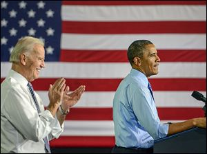 Vice President Joe Biden applauds as President Obama speaks to about 300 at Allegheny County Community College in Oakdale, Pa. Mr. Obama said on Wednesday that he and Mr. Biden were on 'a little road trip.'