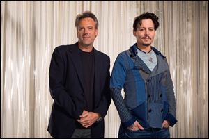 Director Walter Pfister and Johnny Depp during the 'Transcendence' film press junket at the Four Seasons Hotel in Los Angeles.
