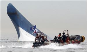 South Korean coast guard officers try to rescue passengers from the sinking ferry.