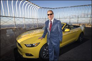 Bill Ford, Ford Motor Company's executive chairman, stands with the all-new 2015 Mustang convertible as it's introduced today on the 86th floor observation deck of the Empire State Building during the New York International Auto Show.