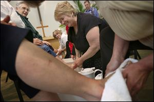 Karen Walker of Lambertville washes the feet of Ronalda Whitmill during a Maundy Th