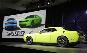 The 2015 Dodge Challenger is introduced Thursday at the New York International Auto Show. With gas prices at an average of $3.45 this year, muscle cars are back in focus at the auto show.