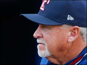 Toledo Mud Hens manager Larry Parrish in the dugout before Thursday's game.
