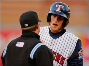 Toledo's Jordan Lennerton argues with the first base umpire after being called out on a pick off attempt in the fifth inning.
