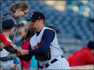 Toledo's Danny Worth signs autographs before Thursday's game.