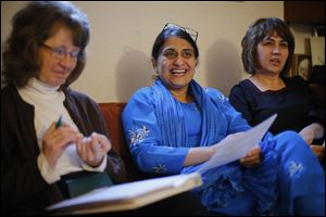 Valerie Garforth, left, Dr. Samina Hasan, center, and Nazife Amrou participate in a Toledo Compassionate community team meeting,