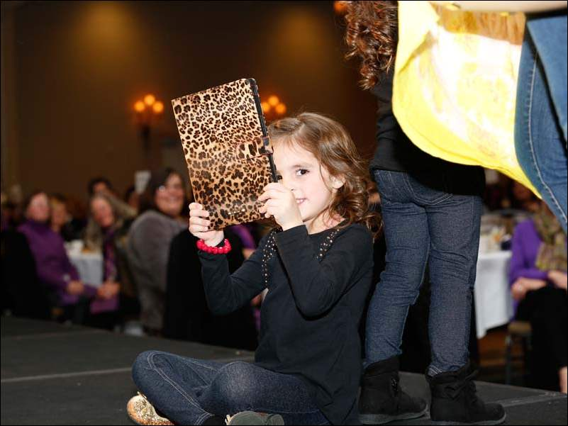 Nadia Chaudhary, 5, on the runway with her sister Sofia, 4, and mom, Cecilia Chaudhary.
