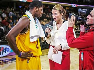Allie Clifton of Fox Sports Ohio interviews Kyrie Irving of the Cleveland Cavaliers. Clifton, a former UT basketball player, decided late in college to pursue TV work instead of teaching.
