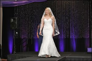 Teresa Hillis models a wedding gown during the 7th annual Luncheon & Fashion Show