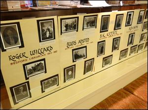 A display of past librarians is pictured at the Bedford branch library.