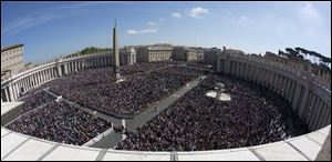 A large crowd is seen in St. Peter's Square from the Bernini colonnade towards Via della Conciliazione avenue, top, during Pope Francis' Easter Mass, at the the Vatican, today.