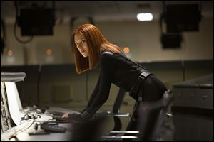 "This image released by Marvel shows Scarlett Johansson in a scene from the film, ""Captain America: The Winter Soldier."""