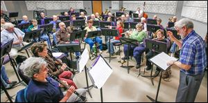 Fred Dais directs the Owens Community College Band for its upcoming spring concert, which will honor World War II veterans and observe the 70th anniversary of the D-Day invasion with a medley of songs.