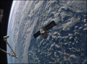 An image from NASA-TV shows the SpaceX Dragon resupply capsule approaching the International Space Station today.