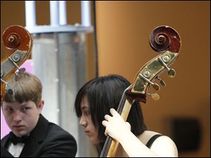 Nick Puterbaugh, a ninth grader, and Ariel Simon, a 10th grader, two of three bassists in the orchestra.