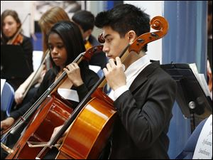 The Sylvania Southview High School Orchestra performs music.