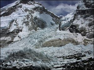 A view of the Kumbhu icefall in 2003, the first hurdle in the ascent to Everest from base camp, is seen from Everest Base camp, where 12 Nepalese guides were killed, Nepal.