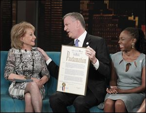 "Barbara Walters, left, with New York City Mayor Bill de Blasio and his wife Chirlane McCray on ABC's ""The View,"" today in New York. De Blasio is proclaiming May 16 as ""Barbara Walters Day"" in New York City."