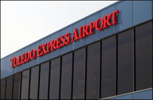 Despite a rise in passenger traffic at Toledo Express, the loss of a flight to Chicago has imperiled a $750,000 federal grant.