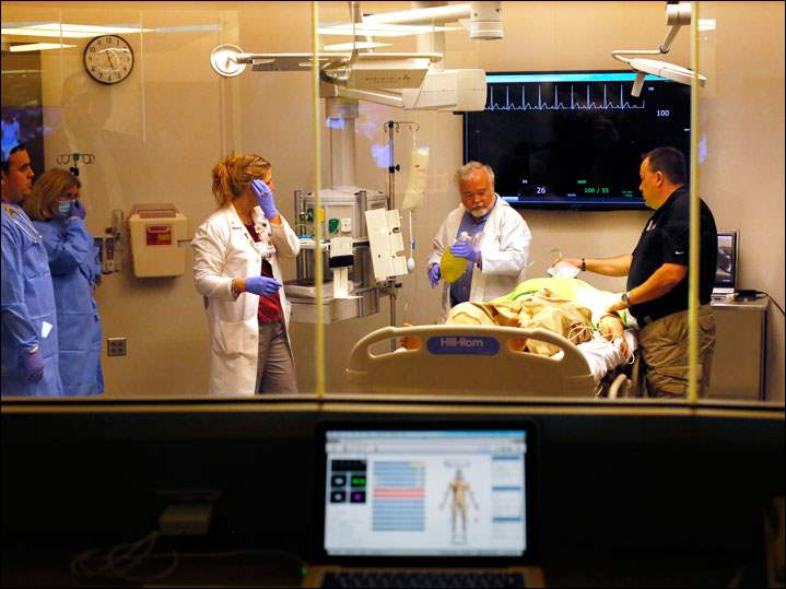 "Staff and students use a virtual hospital room with a ""patient,"" which is a virtual human being.simulation, as well as learn to work as teams in a virtual hospital equipped with human patient simulators."