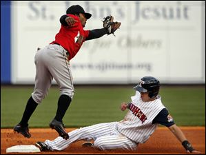 Hernan Perez steals second base against Indianapolis Indians SS Michael Martinez during the first inning.