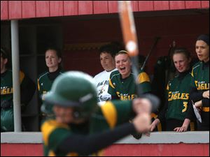 Clay's dugout, including Danielle Lorenzen, center, cheers on their teammate Rebekah Yenrick  at bat.